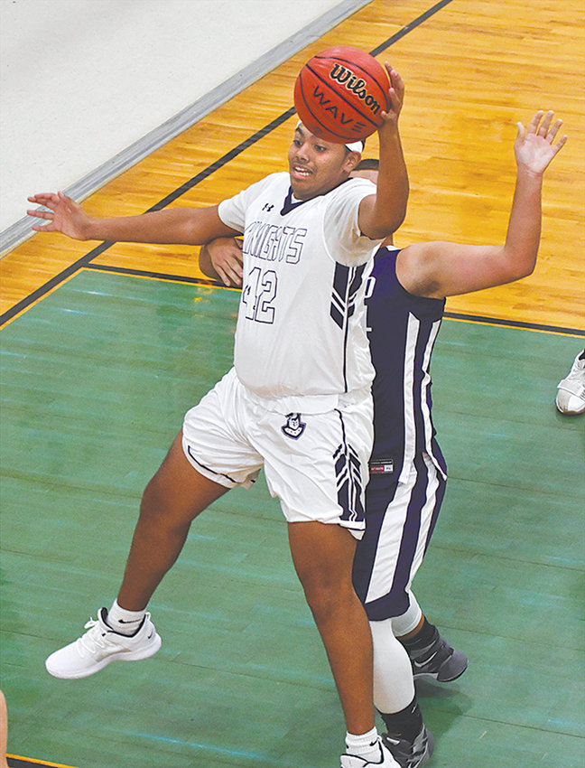 Knight Jordan Hamilton, 42, posts up against Oxford Academy in their season opener. Chatham Charter is 2-0 after beating Falls Academy Friday night.