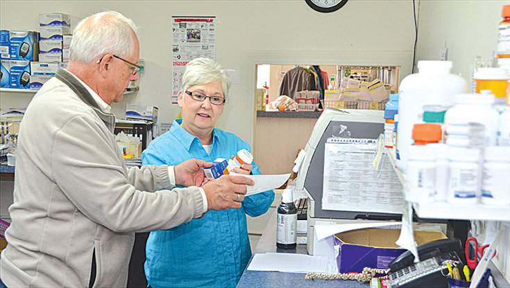 Lynn Glasser, left, and Patricia Dowdy work on a prescription Monday at Chatham Cares Pharmacy, located on Raleigh Street in Siler City