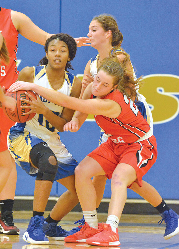 Chatham Central Lady Bear Cami Hughes, right, tries to tie up Lady Jet Ellia Wright in a county rival basketball game last week. Central won their game over J-M, then beat Eastern Randolph Monday night in Ramseur.