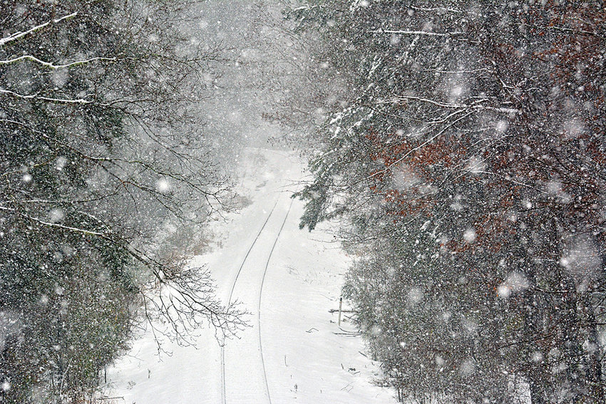 A snowy scene looking down the railroad tracks off of Highway 64 in Siler City.