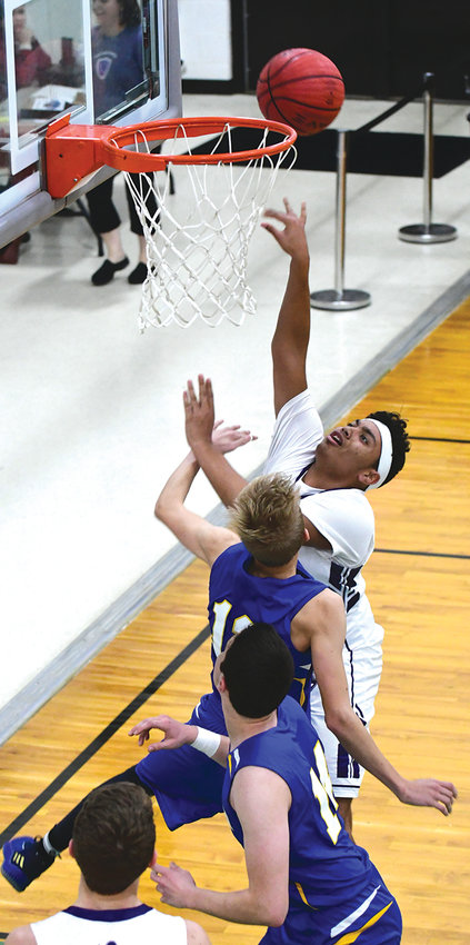 Chatham Charter Knight Jordan Hamilton leans in for a basket against Faith Christian Friday night. The Knights won the game then went on to beat Cornerstone in the finals of their Winter Slam Christmas Tourney.
