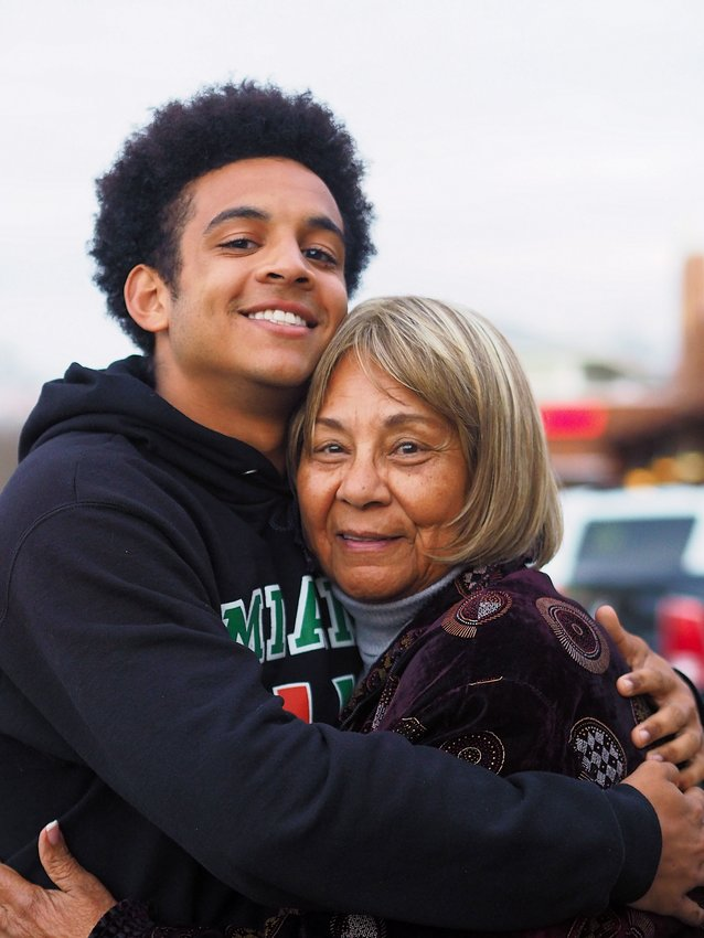Donald Fleming of Chapel Hill  hugs his grandmother, Lily Brabble,  who lives in The Legacy in  Chatham County. (Staff photo by  Kim Hawks)