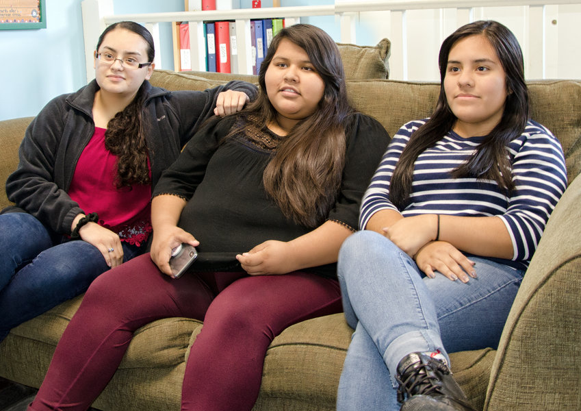 Noemi Mora, Cesia Lopez and Lenore Ramos of Siler City sit in the office of the Hispanic Liaison as they discuss the mental health experience of Latinx teenages.