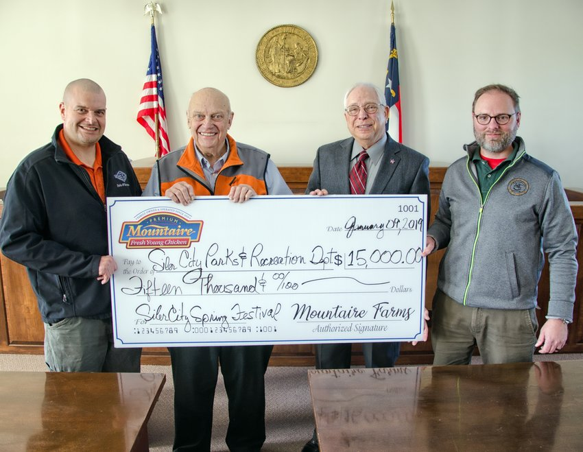 Mountaire's Employee & Community Relations Manager Mark Reif presents a $15,000 check to Siler City for sponsorship of the Spring Chicken Festival to be held on May 4. Shown (from left) are Siler City Parks and Recreation Director Joseph Keel, Siler City Mayor John Grimes, Reif, Siler City Town Manager Bryan Thompson.