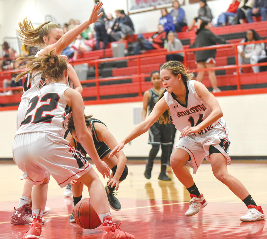 Chatham Central's Cami Hughes (22) and Addie Fields (14) crash in on a Resarch Triangle Adademy ball handler in local high school basketball action down in Bear Creek on Tuesday night.