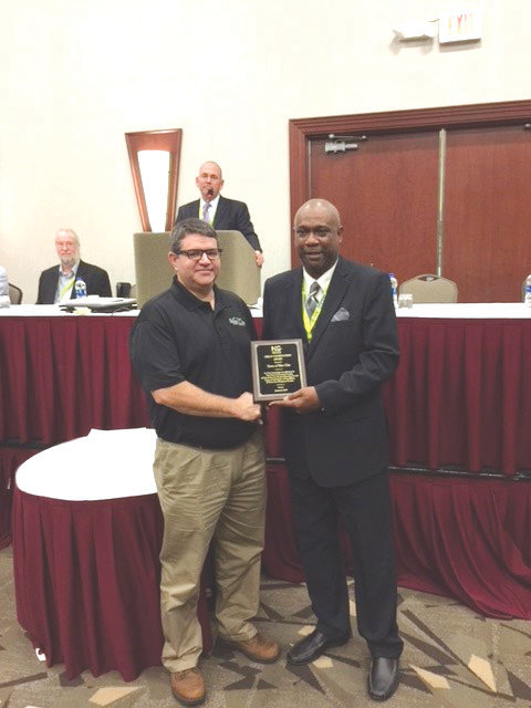 Siler City Planning Director Jack Meadows (left) received the Urban Conservation Award on behalf of the town last month from 2018 President of the North Carolina Association of Soil and Water Conservation Districts Dietrich Kilpatrick.