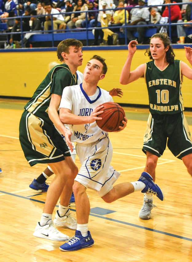 Jordan-Matthews' Seth Moore drive the baseline on Thursday night in Siler City in the Jets victory over Eastern Randolph.