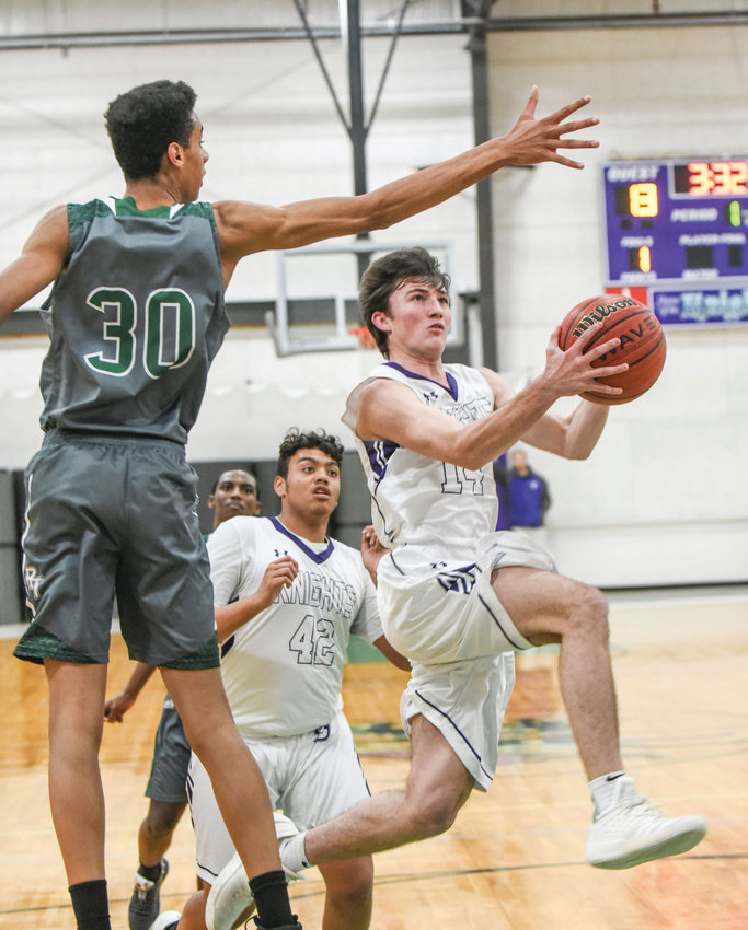 Chatham Charter's Connor Murphy (right) drives to the hoop on Tuesday night in Siler City in the Knights key 66-64 victory over Research Triangle Academy.