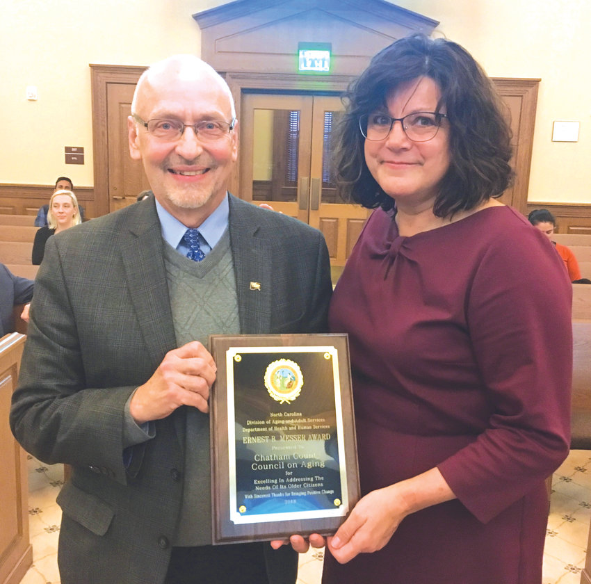 Chatham County Council on Aging Executive Director Dennis Streets, left, stands with Joyce Massey Smith, director of the N.C. Division on Aging and Adult Services, after the COA received the state's 2019 Ernest B. Messer Award for excellence in senior services.