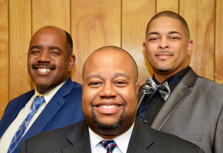Despite just 2 percent of educators across America being black males, Chatham County Schools has three in major administrative roles: from left to right, Chris Poston, executive director of elementary and middle grades eduction; Derrick Jordan, district superintendent; and Melvin Diggs, executive director of the EC and AIG programs.