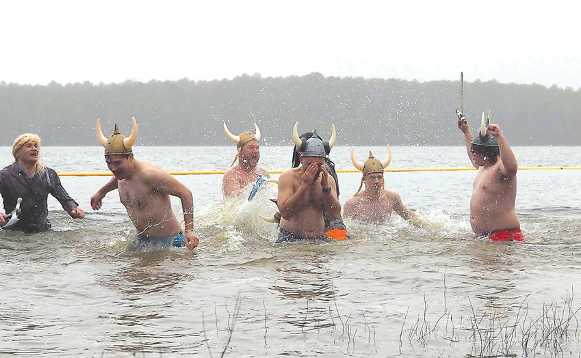 Capt. Chris Cooper (left) took to the frigid Jordan Lake waters with the Polar Plunge Vikings.