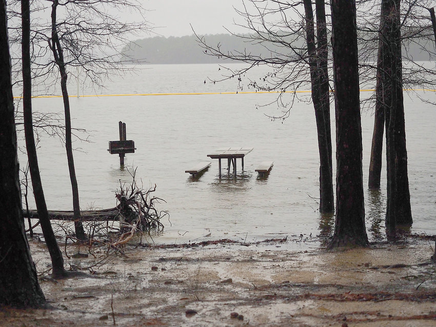 The waters of Jordan Lake are again rising due to rains. Picnic tables at White Oak are again under water.