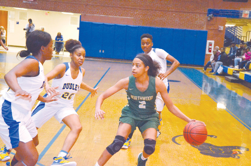 Dudley's Iysis Whitfield,Kyra Rhymer and Symphony Jackson guard Northwood's Rae McClarty as they battle in a highly-contested matchup Tuesday night at Dudley High School in Greensboro.