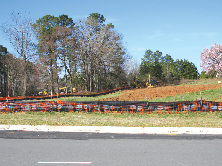 Contractors began work last week on grading Mosaic at Chatham Park. Developer Kirk Bradley said construction on buildings is expected to begin later this year.