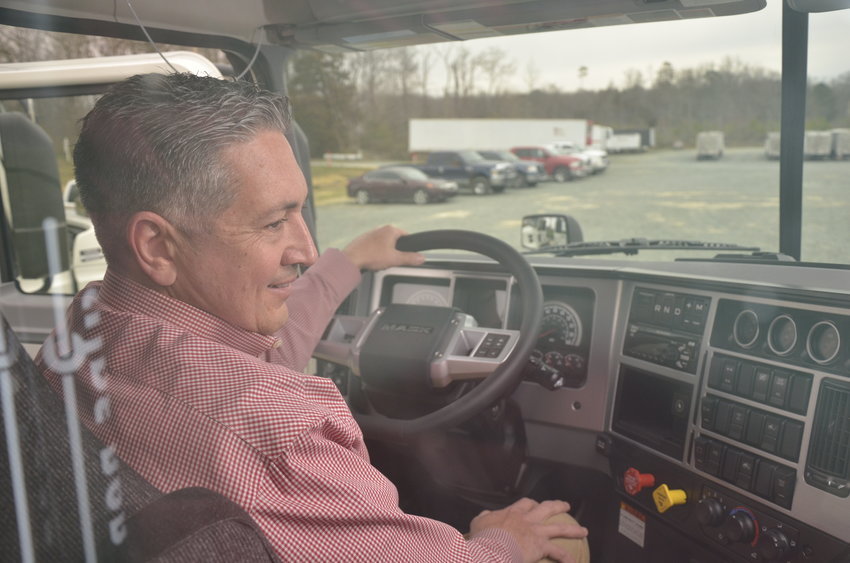 Wilson Brothers President Jeff Wilson sits in the cab of one of his company's newest trucks. Wilson said he spends some time out on the road himself, but can be found most of the time at the company's facility in Bear Creek.