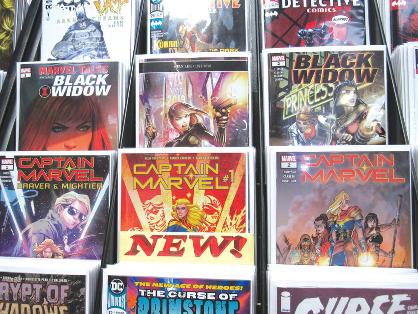 Lining the shelves at Ultimate Comics Durham are the latest issues of comic book arcs, including 'Captain Marvel' and 'Black Widow.' These characters have gained significant popularity through popular movies that have grossed billions of dollars in recent years.
