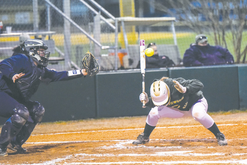 Northwood's Grace Leonard ducks out of the way of a high pitch last week in area softball action in Pittsboro.