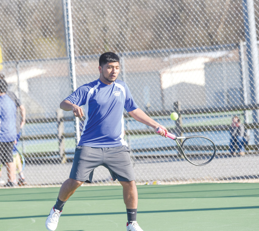 Jordan-Matthews' Felix Sifuentes prepares to strike a shot back against Chatham Charter last week in local high school tennis action.