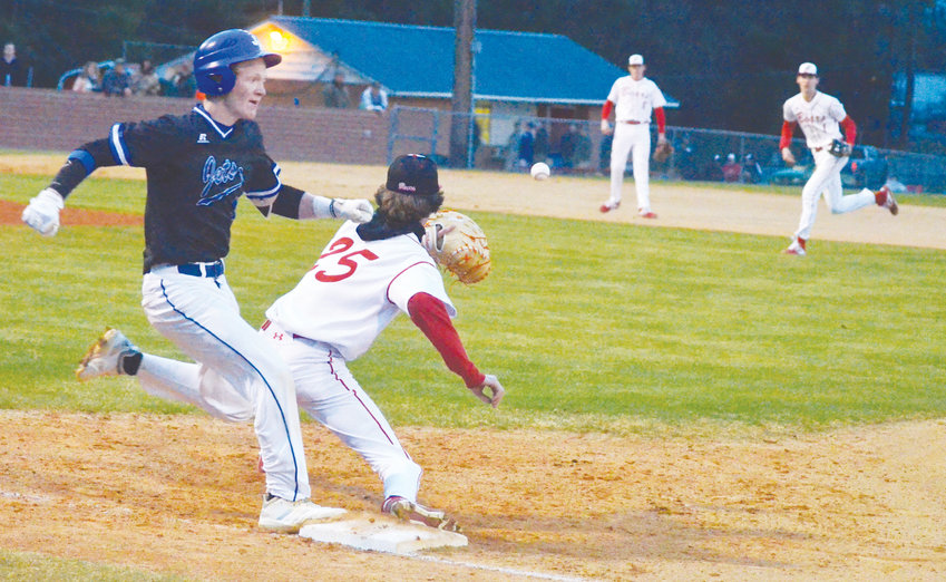 Jordan-Matthews' Christopher Morgan beats the throw to home team Chatham Central's Hunter Strickland in the top of the first inning Thursday. The home field advantage didn't work, as Central lost 4-1.