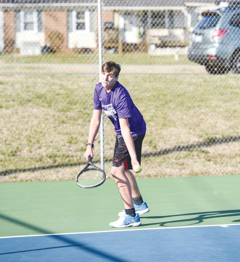 Chatham Charter's Tristan McInturff prepares to serve in high school tennis action last week in Siler City. The Knights took down Clover Garden and Jordan-Matthews in a pair of early season wins.