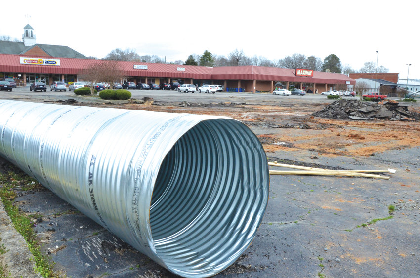 A steel tube will be installed, replacing a worn-out culvert, to better manage stormwater flow at the Maxway parking lot. Stormwater in the Loves Creek Watershed has been flooding the lot — and nearby businesses — for decades.