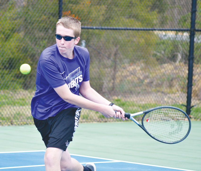 Chatham Charter's Collin Samrad smashes the ball across the net during a match with Cornerstone Charter at Chatham Charter High School Wednesday afternoon.