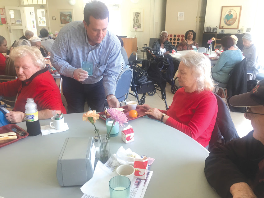 Chatham County Manager Dan LaMontagne helps serve meals to Judy Hatcher (left) and Thelma O'Daniel during the Chatham County Council on Aging's 17th annual March for Meals event March 19 at the East Chatham Senior Center.