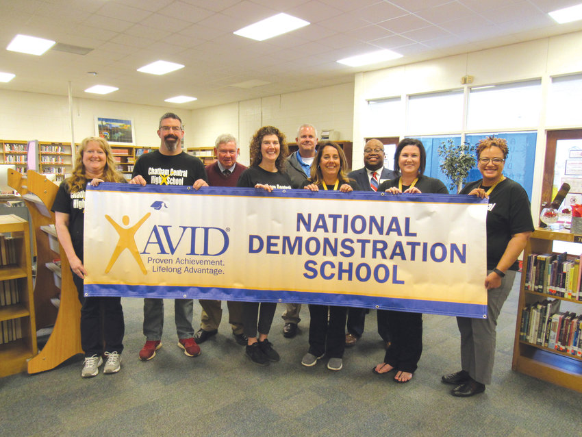 Chatham Central High School and AVID staff hold a banner designating the school as an AVID Demonstration site on March 28. The school became just the second high school in North and South Carolina to earn the recognition.