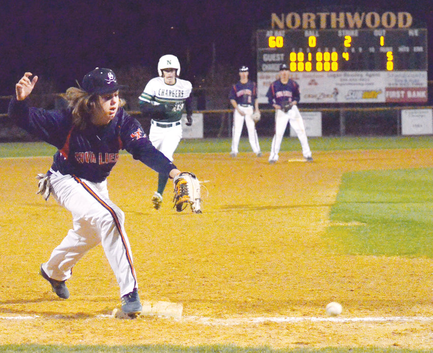 Southern Lee's Mike Remaley misses the toss to 3rd base in the 7th inning at Northwood's Ronald Horton park in Pittsboro Wednesday as Northwood's Beau Weathers goes for third to even up the score.