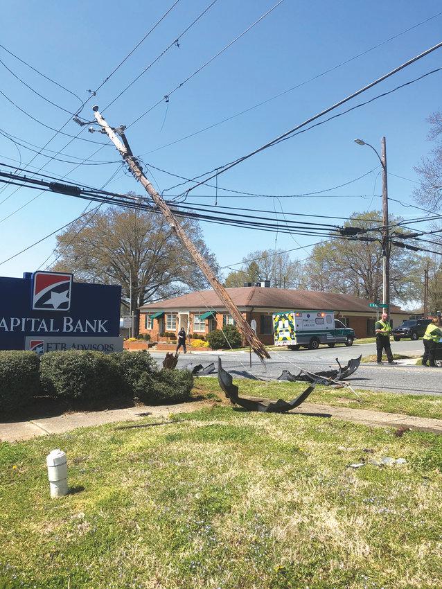 The accident split the utility pole and knocked out power in the area, forcing the Capital Bank to temporarily close on Thursday.