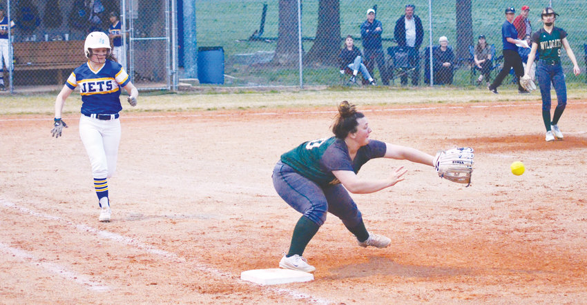 Jets go for a base hit.Jordan-Matthews' Ashlyn Ray heads for first as Eastern Randolph's Olivia Hall makes the play at first. The Jets struggled to overcome a 3-0 deficit before finally losing the game.