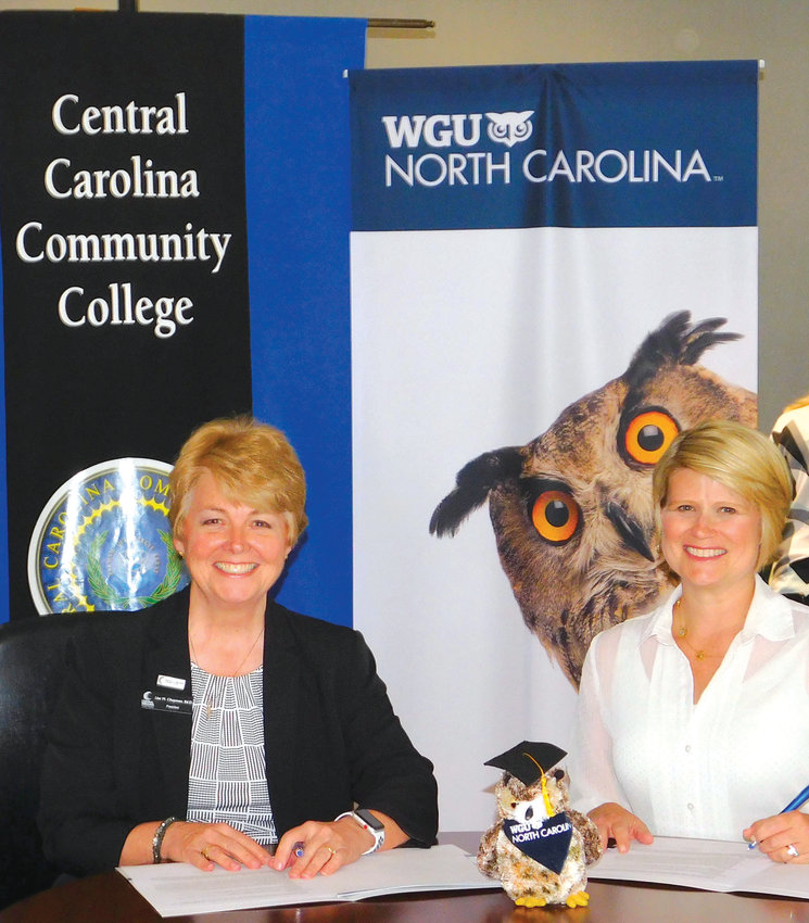 Central Carolina Community College President Dr. Lisa M. Chapman (left) and WGU North Carolina Chancellor Catherine Truitt sign a Memorandum of Understanding that will ease the transition for CCCC graduates to pursue bachelor's degrees offered by WGU, provide tuition discounts, and provide access to scholarship funds.