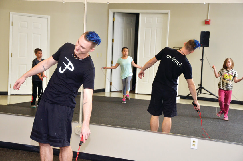 After becoming a competitive jump rope champion, Zac Tomlinson now leads classes in the sport for the Chatham Parks and Recreation department. Tomlinson's class Monday night in Pittsboro brought Lawson Cotten (from left), Kai Walker and Osa Becker to learn techniques of the sport.