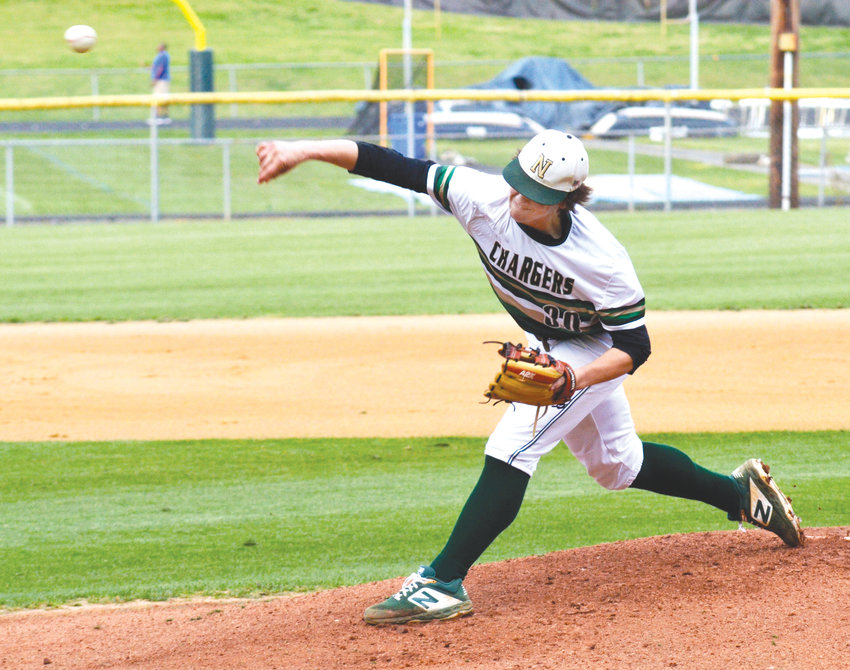 Northwood pitcher Luke Popp delivers it high and fast in the first inning of Wednesday's game against East Chapel Hill in PIttsboro. Northwood tied the game in the fifth inning before East scored a final run in the sixth.  Northwood lost 6-5.