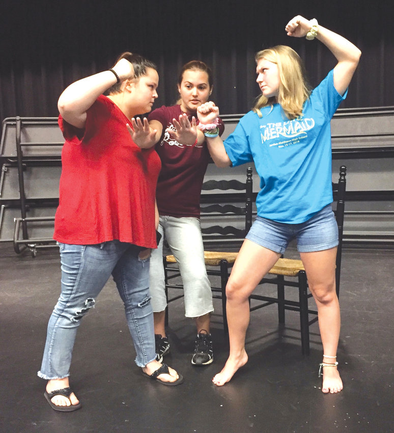 Laci Burt, from left, Natalie Santiago and Hannah Redding 'freeze' during their devised fight scene. Students will create similar improvised scenes as part of the free Scene X Scene performance showcase on May 2 at Jordan-Matthews High School.