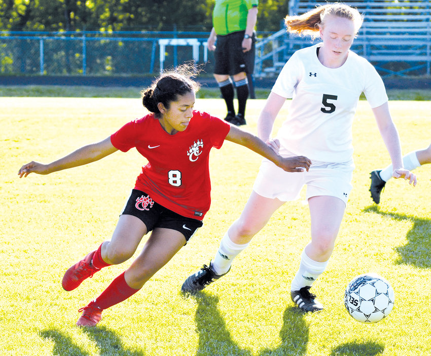 Chatham Central's Brenda Soriano comes around Woods Charter's Anna Mitchell during Tuesday's game at Chatham Central. Woods Charter shutout the home team with a 9-0 score.