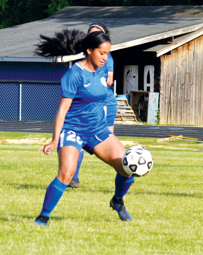 Aiming for the goal..Jordan-Matthews' Janet Solano gets through defenders in recent high school action.