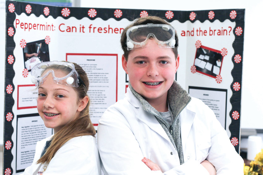 Chatham Middle School eighth graders Macy Beavers, left, and Brady Andrew won state science fair honors for their experiment on the effect of peppermint on reaction time and how that might relate to standardized testing.