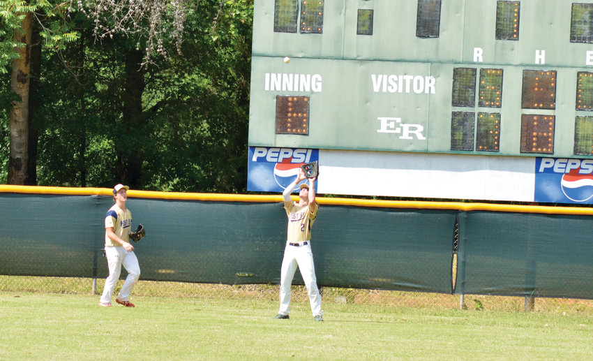 American Legion Post 81's Travis Boone, left, and Cade Snotherly come in for a deep ball to center field early in the sixth inning at Eastern Randolph. Post 81 played their first game of the season against Post 116, with a victory for Post 116, 7-4.