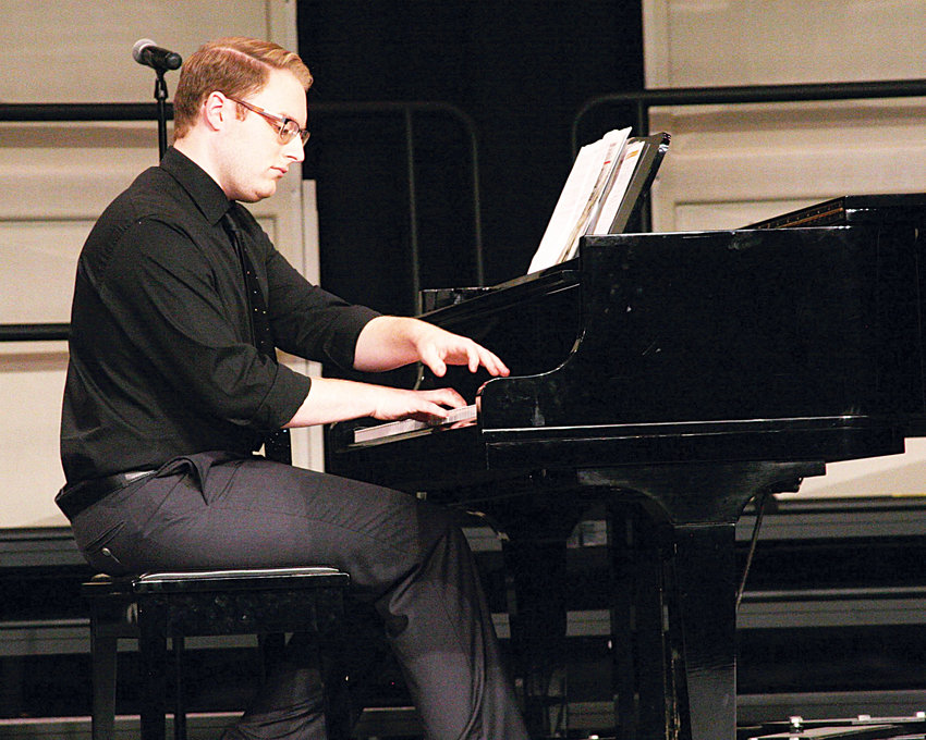 Heath Smith appeared at Jordan-Matthews High School as pianist for Jennifer Trejo Benitez in her performance of 'Beyond My Wildest Dreams' at the annual Music in May concert.