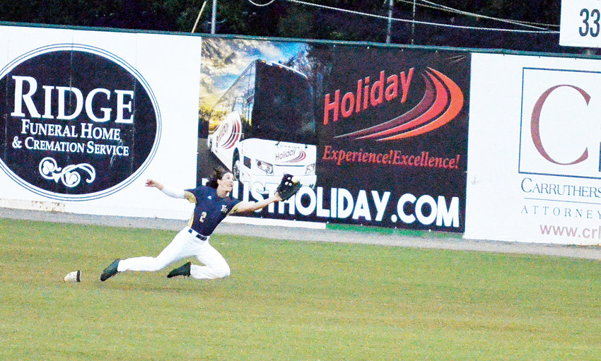 Post 81's Cade Snotherly dives for the ball in center field Friday at McCrary Park in Asheboro in their game against Post 342. The contest on the cool night resulted in a loss for Post 81, 8-2.