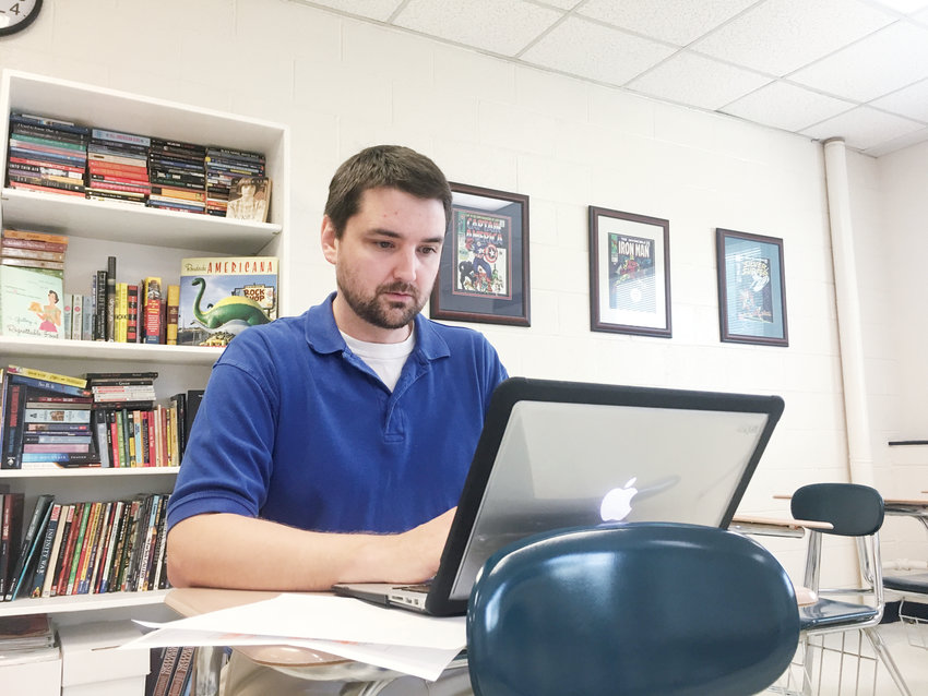 Jordan-Matthews High School English teacher Doug Riggs responds to student emails Monday during a teacher workday on campus in Siler City,