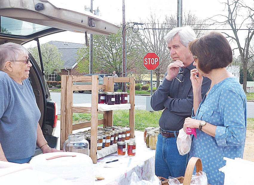 Joan Thompson of Siler City sells baked and canned goods at the Siler City Farmers' Market at Oasis. Farmers and other merchants can get a discount to rent space at the Market to offer home-grown products for sale at the Oasis.