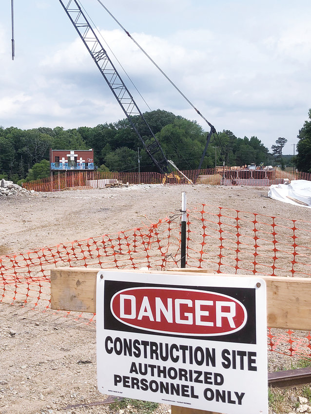 The contractor for the replacement of the Carbonton Bridge has been declared 'in default' by the NCDOT. The bonding company is now required to find a new construction company to complete the project. No timeframe for completion has been outlined.