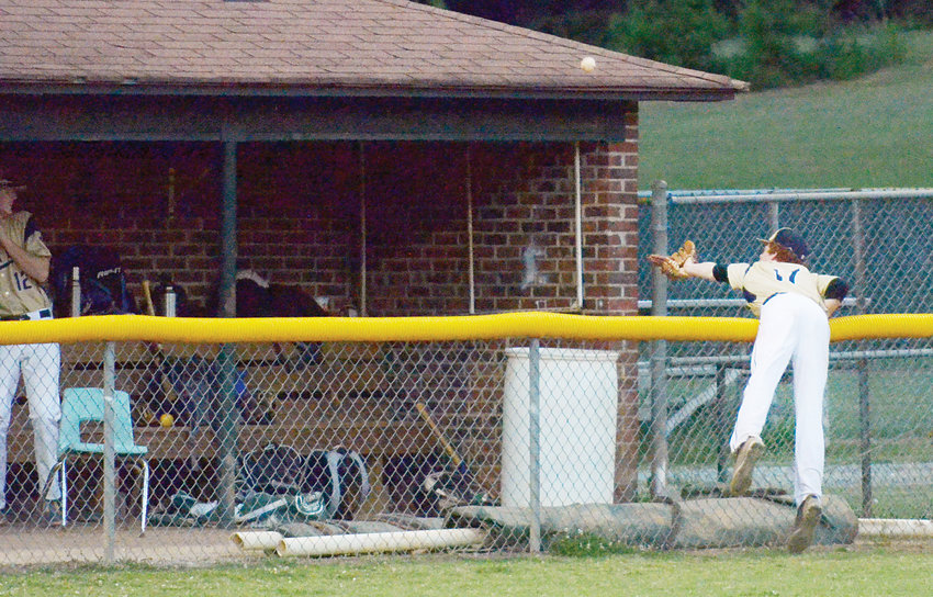 Post 81's Clay Edmondson tries for a foul ball catch in Friday's game with Post 37 from Kernersville at Grady Lawson Field in Ramseur. The ball landed out of reach, and the game was out of reach for Eastern Randolph, losing 12-1.
