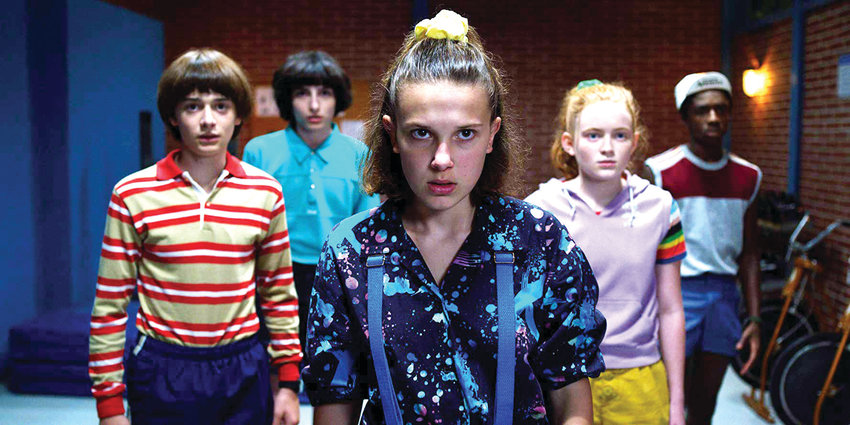 """From left to right, Noah Schanpp, Finn Wolfhard, Millie Bobby Brown, Sadie Sink and Caleb McLaughlin star in a scene from season three of Netflix's """"Stranger Things."""""""