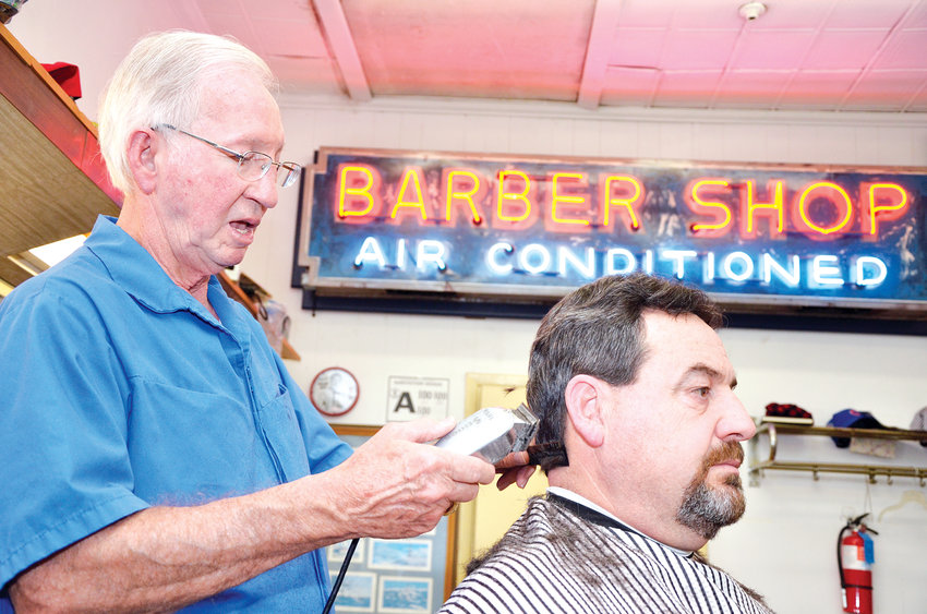 Cadle Cooper, owner of Cooper's Barber Shop in PIttsboro, gives Kimble Wallace a haircut. Wallace is a regular and loyal customer and has been coming to Cooper's shops for 30 years.
