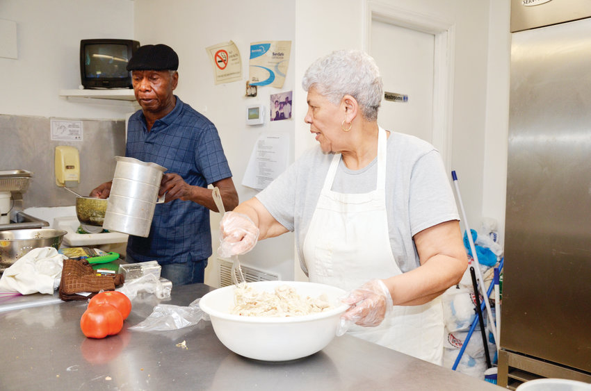 Robert Scurlock, left, assists his wife Marsha in the catering business, but not with the cooking. He can't cook, he said.