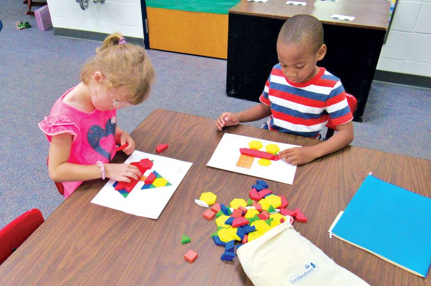 Clara Wachs, left, and Sadeeq Abdullah arrange blocks into the shape of a boat and a train during Monday's first day of Chatham County Schools' Kindergarten Readiness Camp at Bonlee School.
