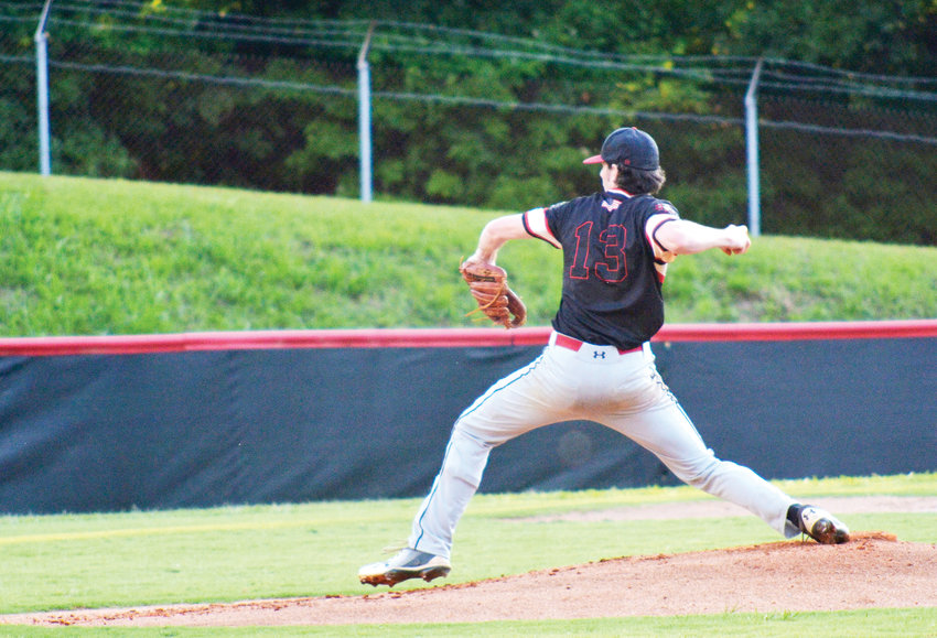Deep River Muddog Clay Richardson delivers the pitch in recent Old North State League action. Monday's game against the Whitetails was a substantial victory for the Muddogs, winning 11-0 at Craven Stadium in Ramseur.